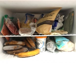 frozen bananas and other frozen food in a freezer