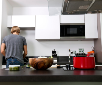 man cooking in clean kitchen