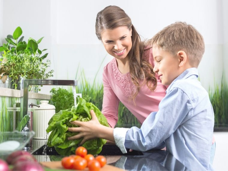 mom and son washing vegetables