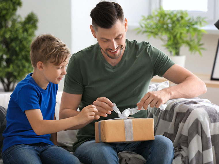 man opening minimalist gift for him from son