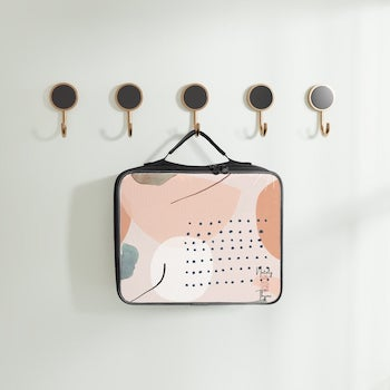 neutral abstract minimalist aesthetic lunch box hanging on row of hooks
