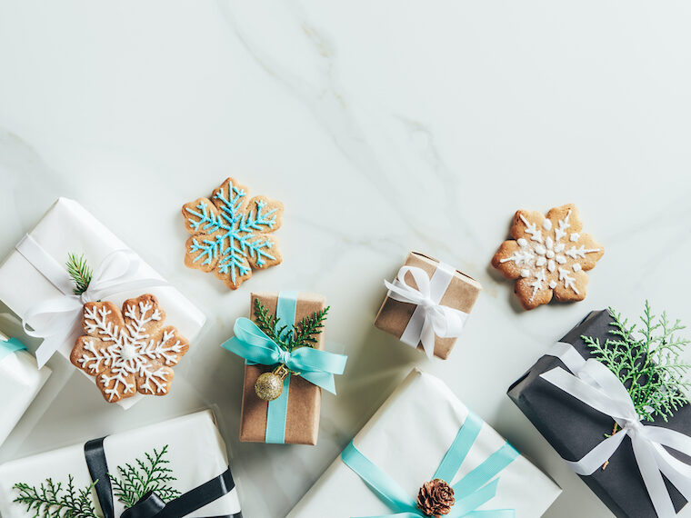 white, black, teal minimalist gifts for Christmas flatlay